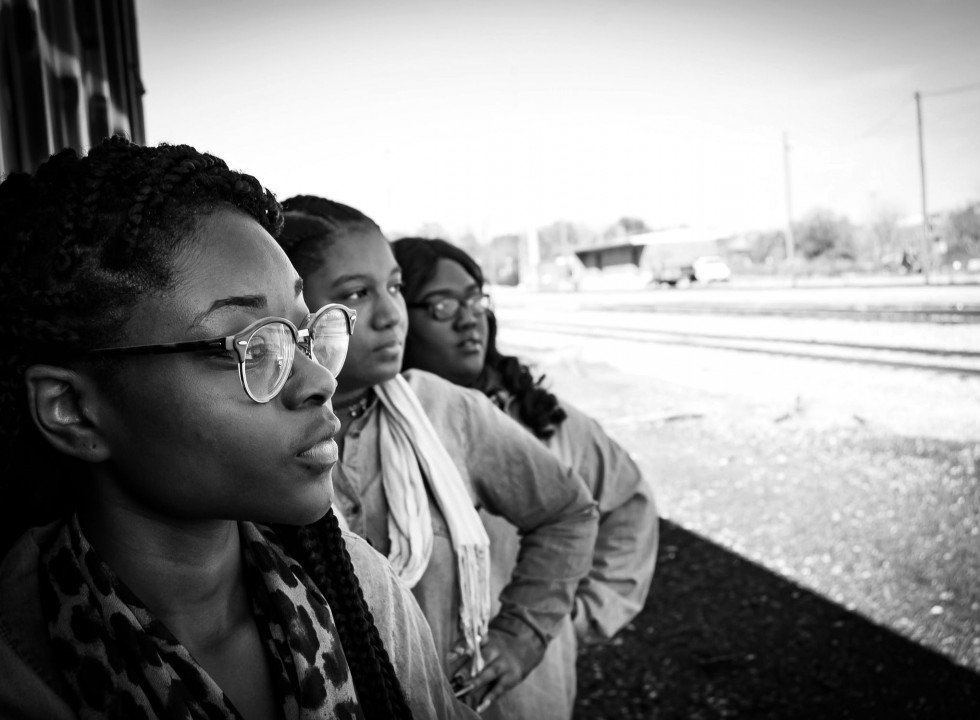 group of young women looking off into the distance