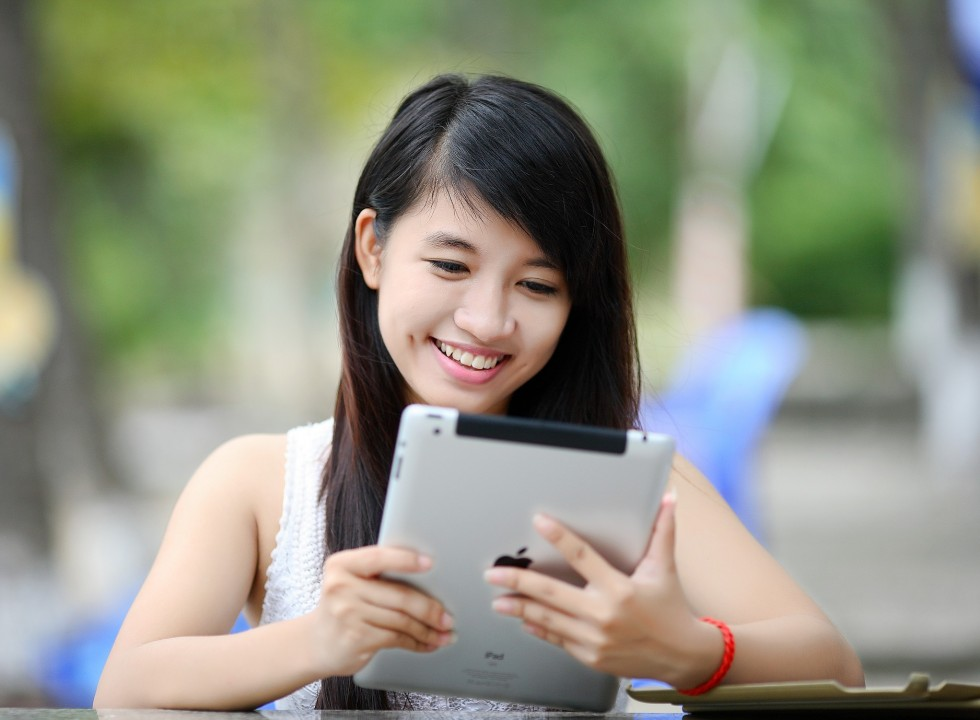 young person looking at an ipad